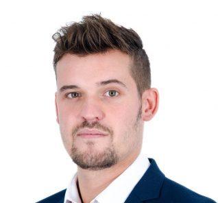 Alex Christie Headshot Nov 2017 - lo res